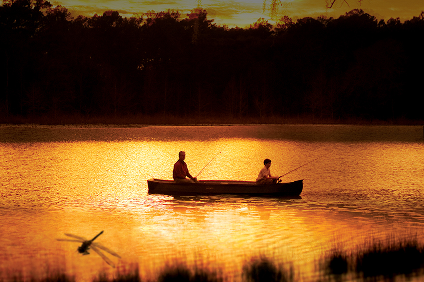 Men on a canoe on Lake Jackson at Sunset